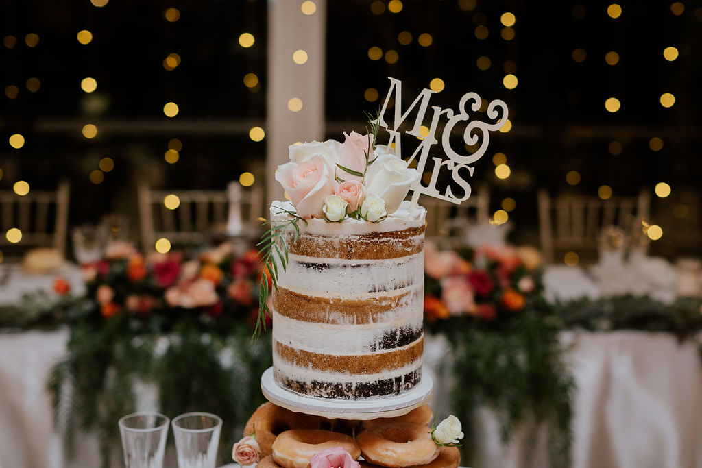 Naked wedding cake with flowers.jpg