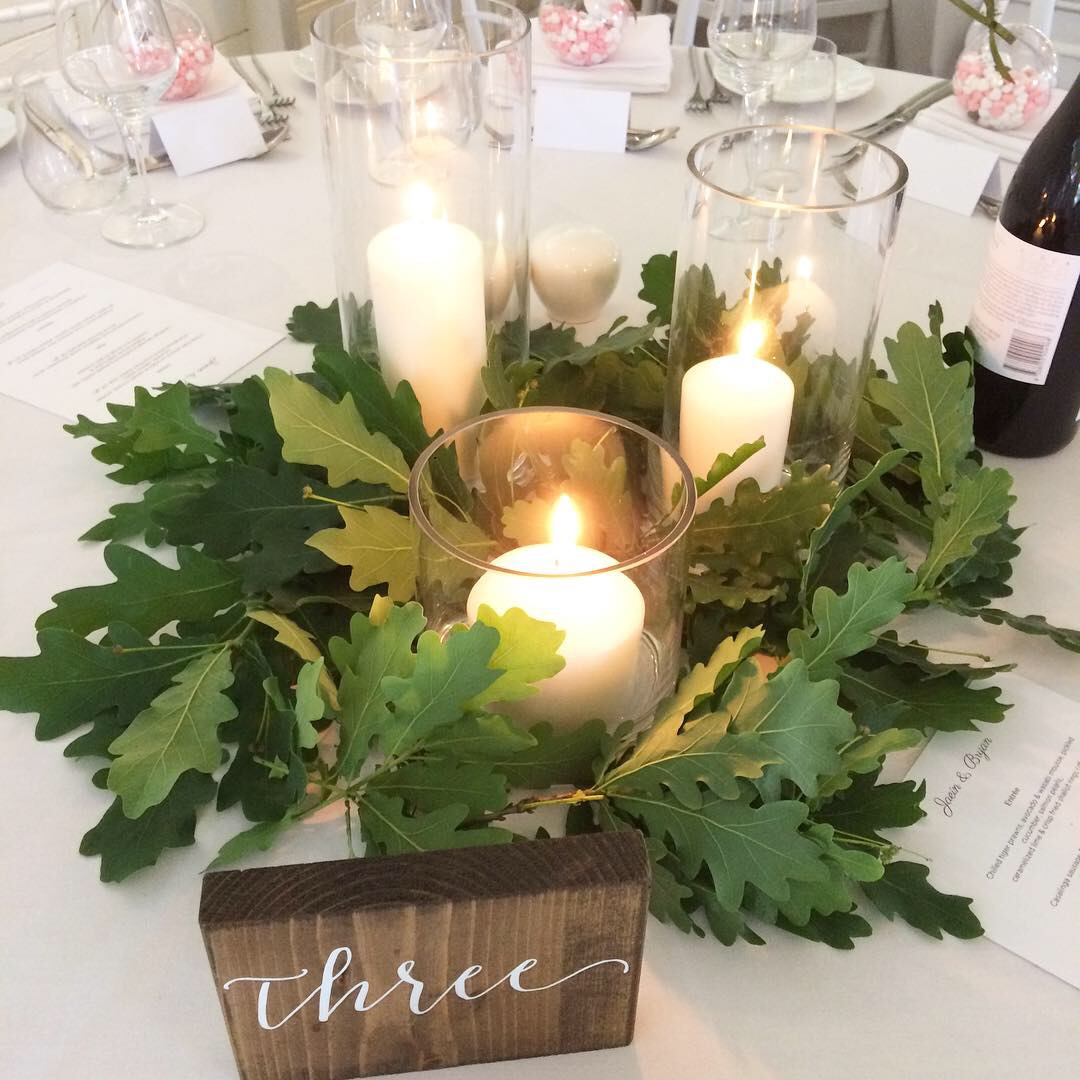 candles and greenery table centerpiece wedding.JPG