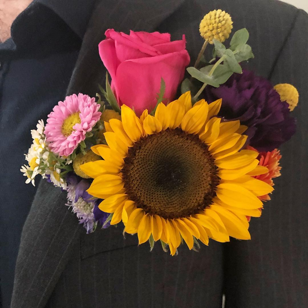 Pocket flowers for groom.jpg