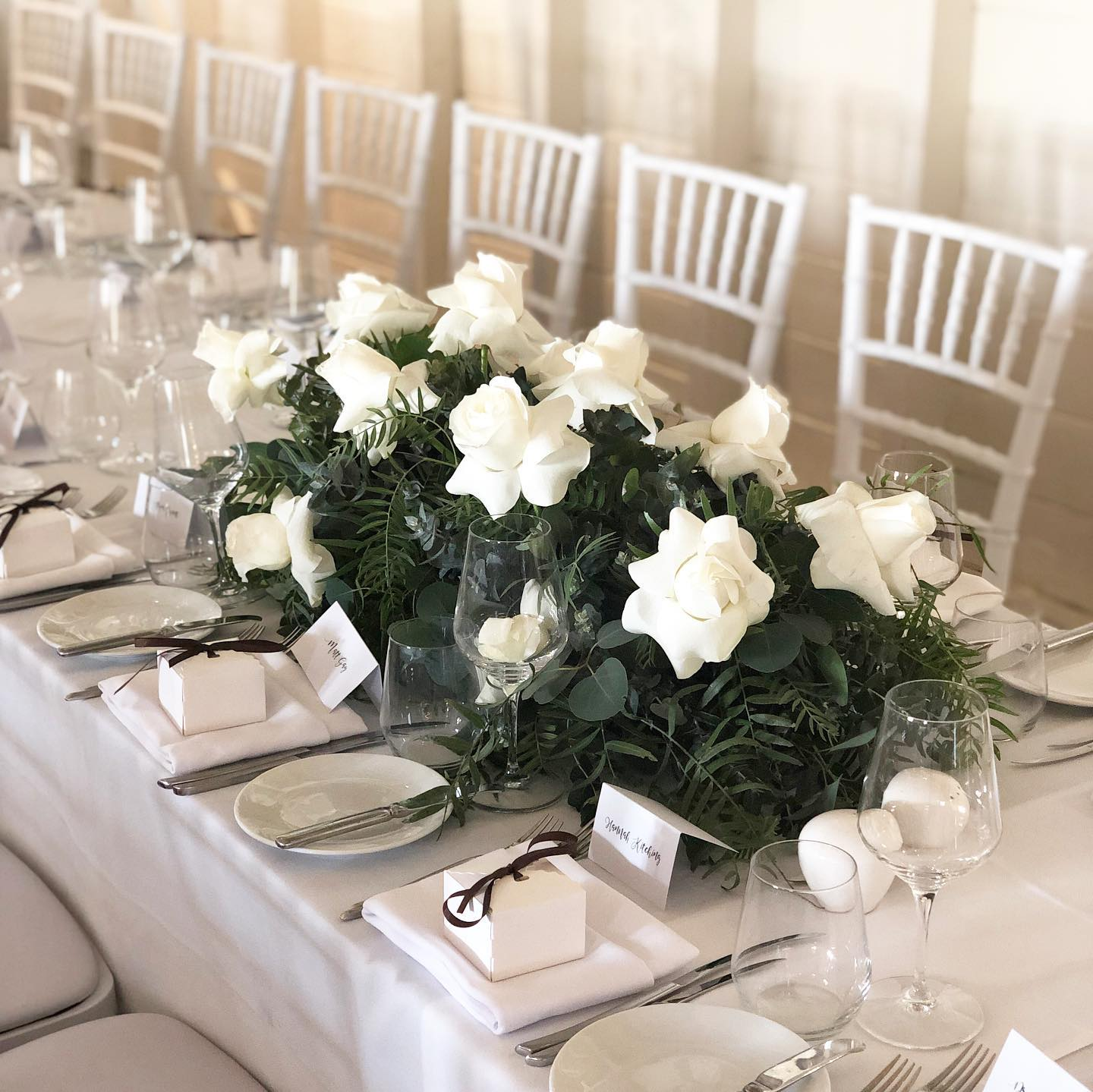 White and green table flowers for wedding.jpg