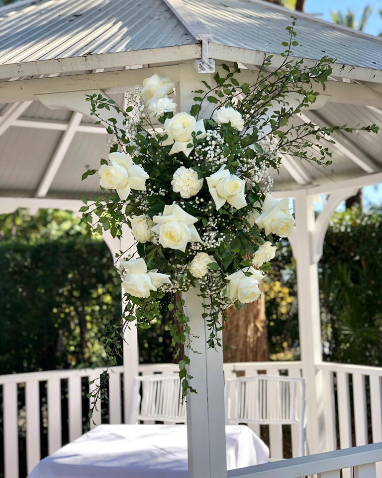 white and green gazebo flowers.jpg