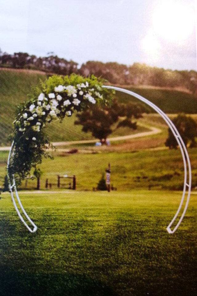 Round arch for hire $100. Flowers and decor are not included.