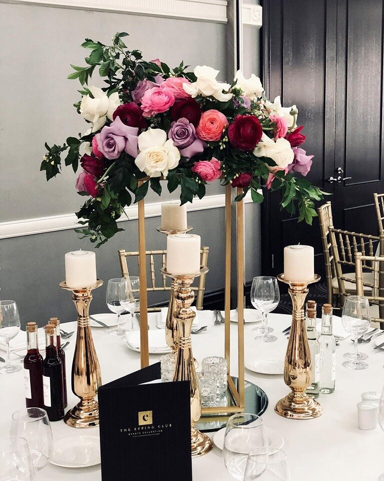 tall table centerpieces on stands.jpg