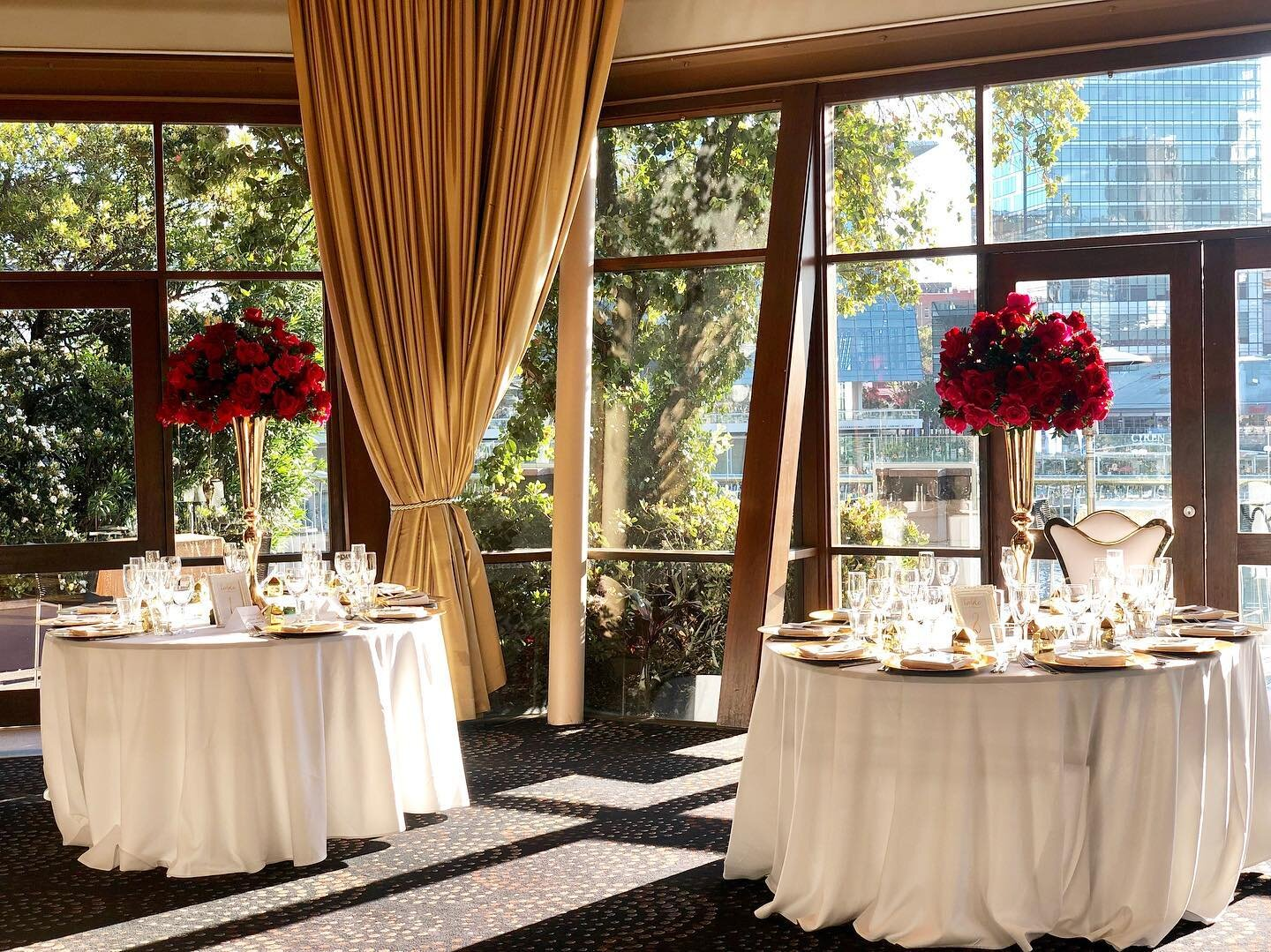 tall floral centerpieces red in gold vases.jpg