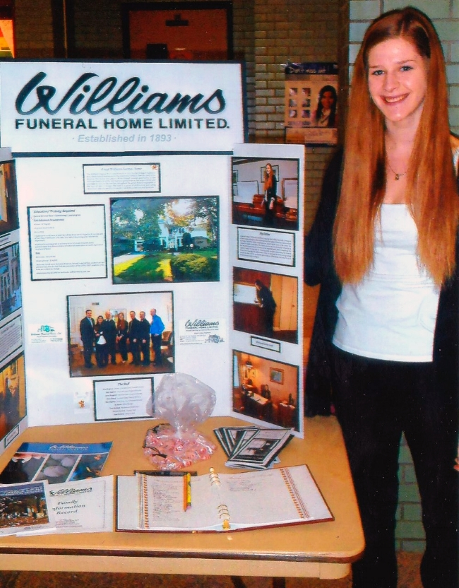 Mikayla with her set-up and display at the Parkside Collegiate Job Fair.