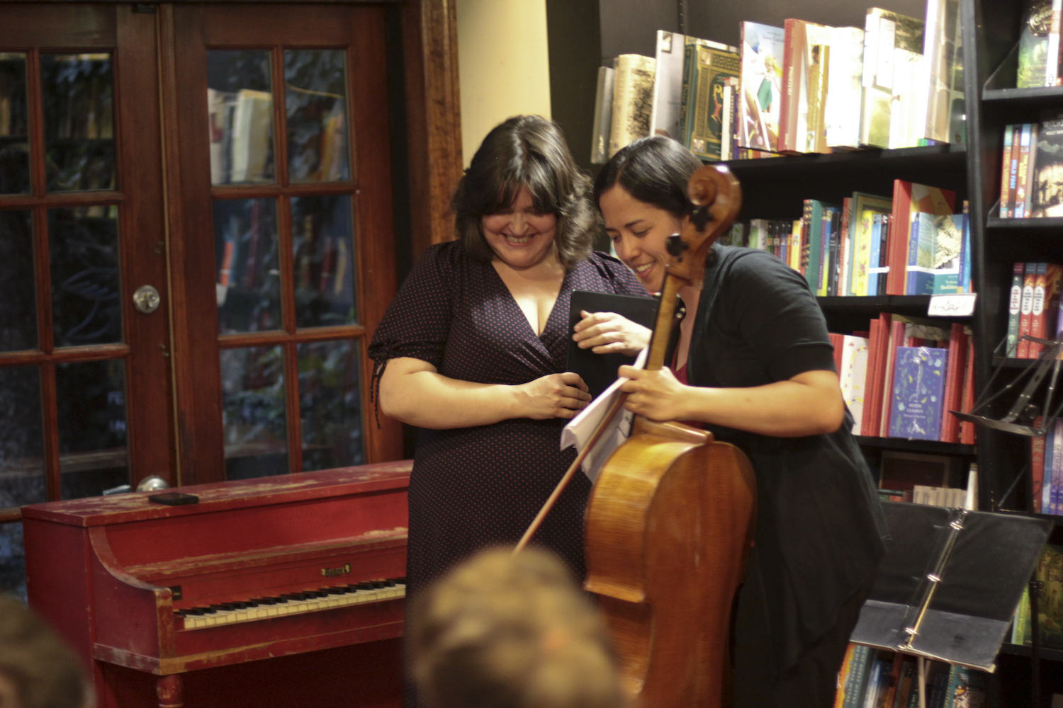 Luthien Brackett (right) and Hannah Collins (left) conclude a pre-event rehearsal.