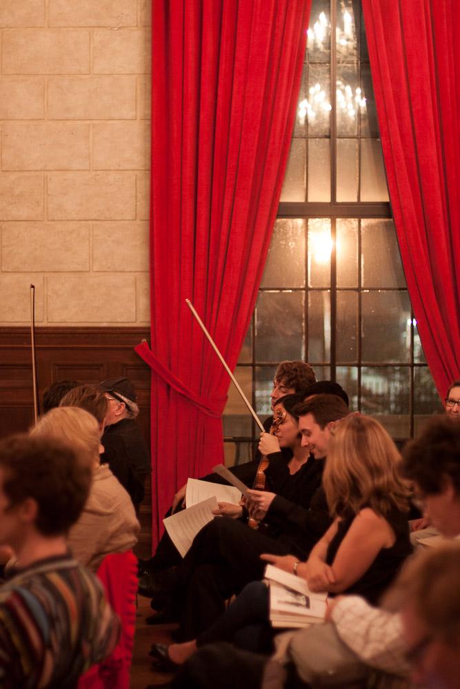 The musicians enjoy a presentation between performances.
