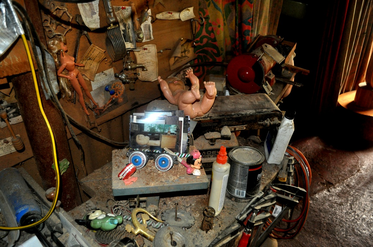 The worktable in Kent's studio was littered, as were many surfaces, with damaged Barbies and other broken-down, forgotten, discarded toys.
