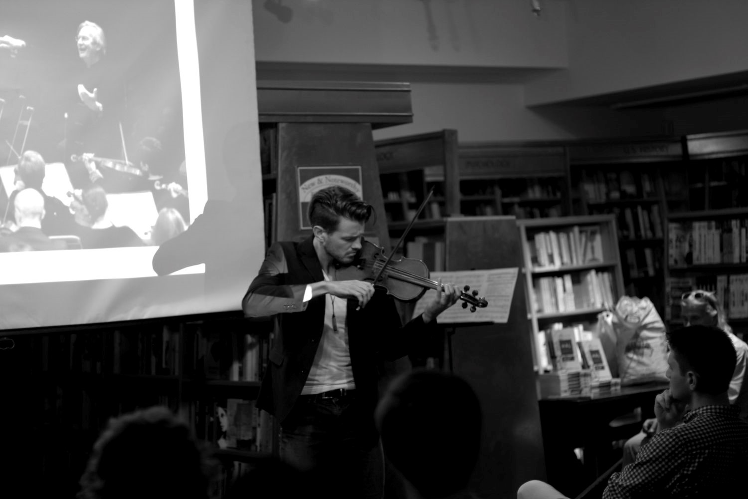The violinist Filip Pogády performing a piece composed by Barry Guy for his wife Maya Homburger