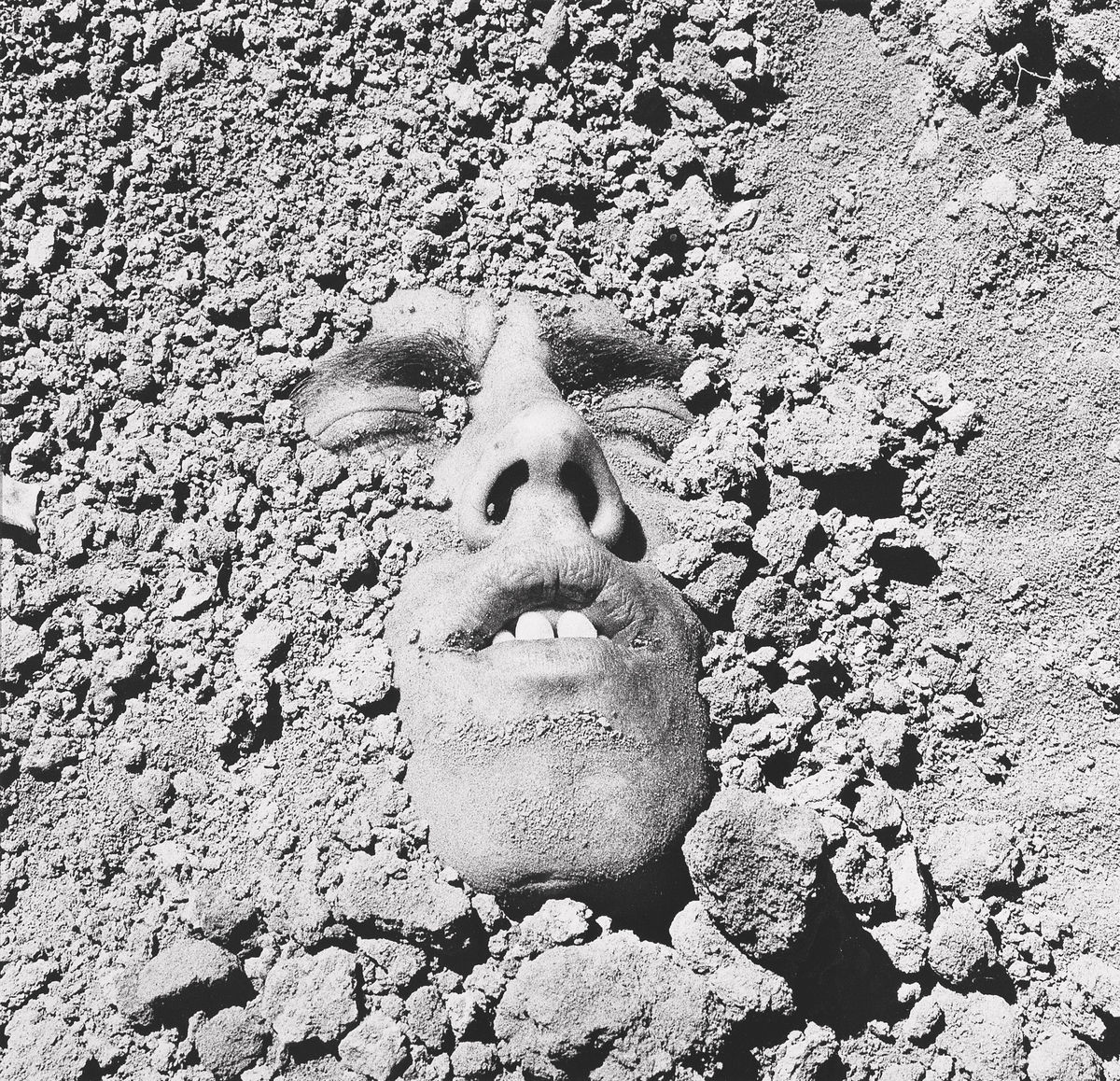 David Wojnarowicz (1954–1992),  Untitled (Face in Dirt) , 1991 (printed 1993). Gelatin silver print, 19 × 23 in. (48.3 × 58.4 cm). Collection of Ted and Maryanne Ellison Simmons. Image courtesy the Estate of David Wojnarowicz and P.P.O.W, New York.