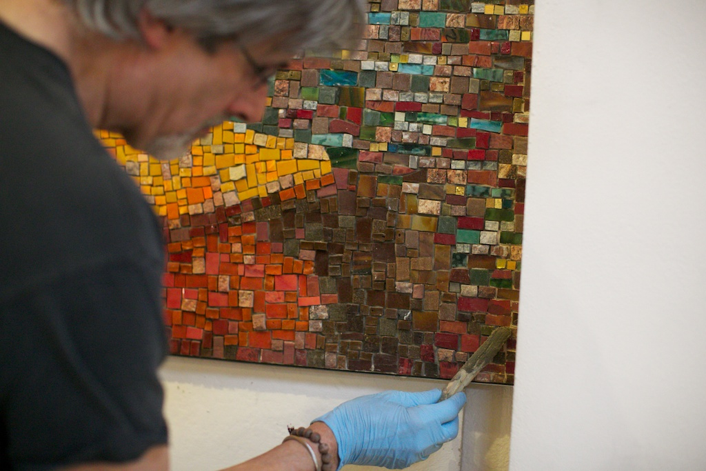 Stephen Miotto, fabricator, putting the finishing touches on the installation of the mosaic.  Photo © 2014 Anabella Wewer