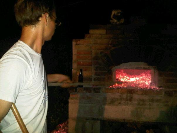 Daniel tending the 1500 degree hearth, circa 2009.