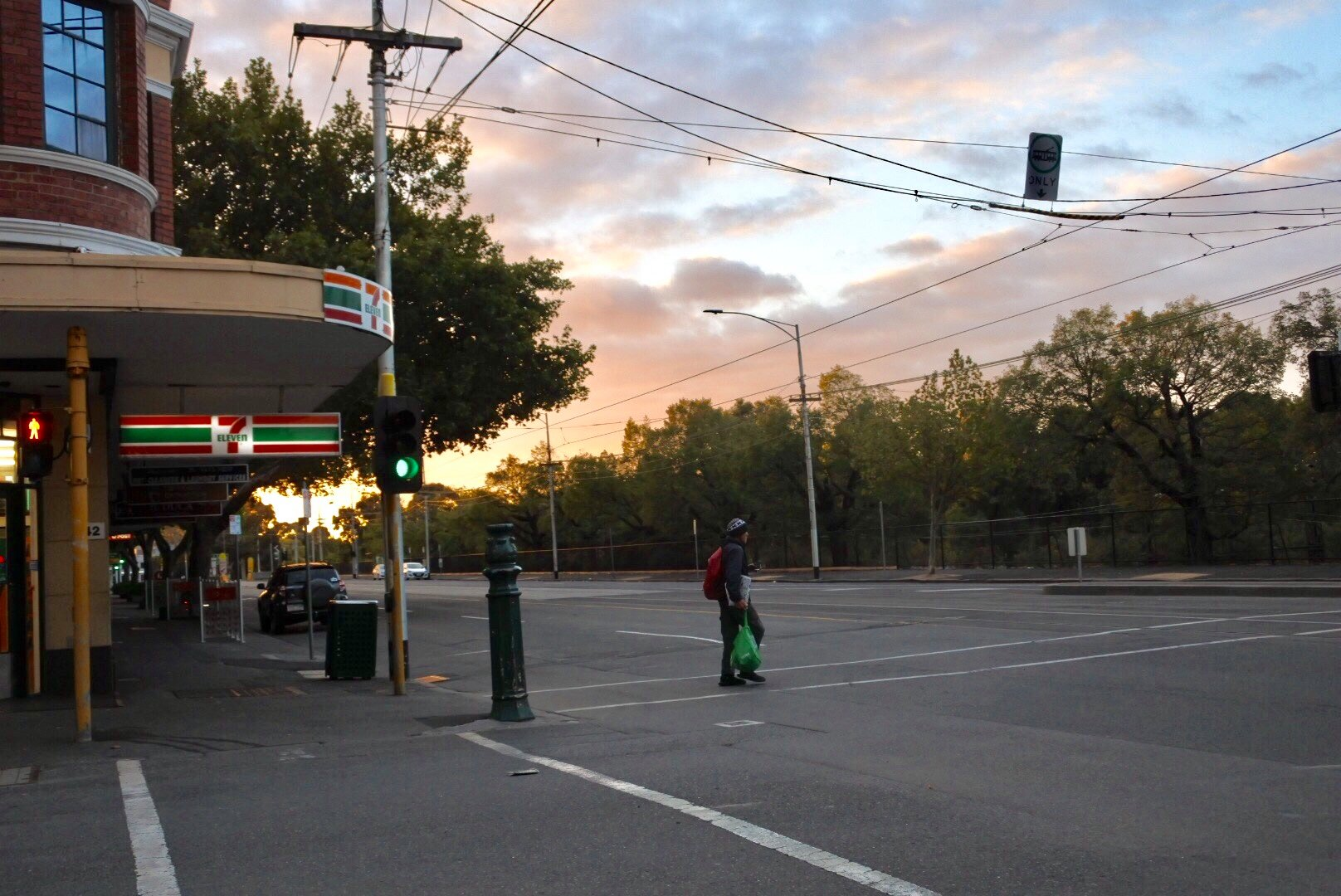 A man resembling our protagonist crossing the street at Powlett Street and Wellington Parade, East Melbourne.  Credit Courtesy of David Cate
