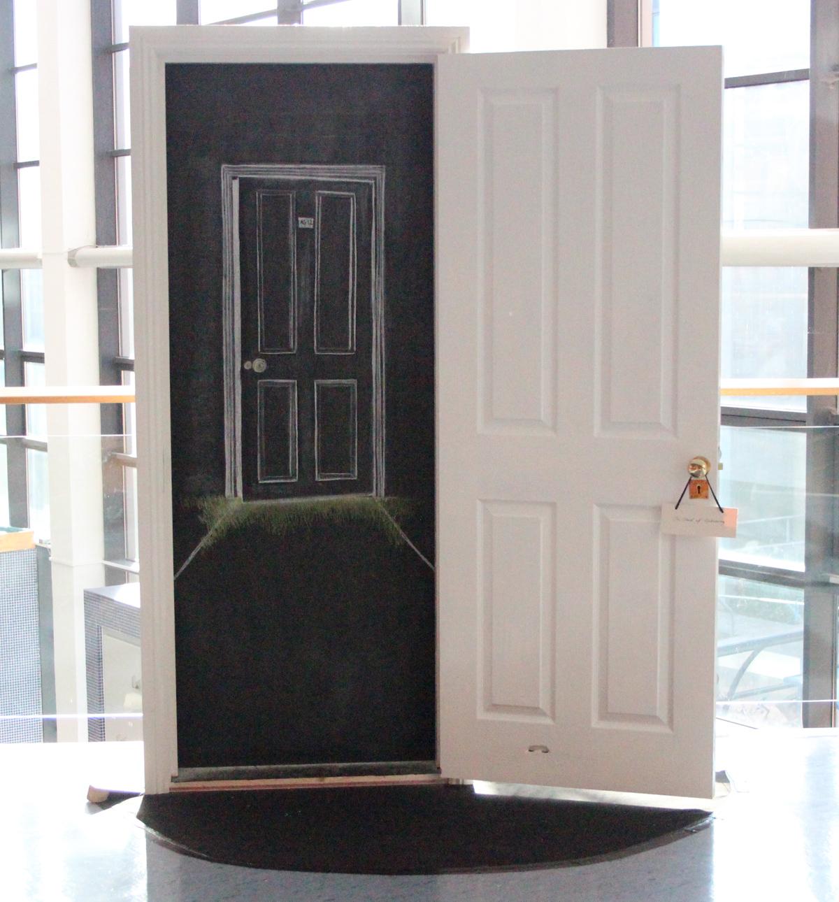 The door to AG 12 is cracked ajar.