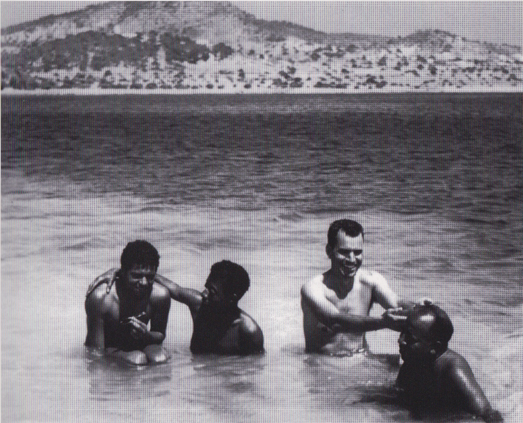 "Photograph by Leslie Schenk of (l-r), ""Arnold"", James Baldwin, Lawrence Calcagno, and Beauford Delaney in Ibiza, Spain, 1956. Courtesy of David Leeming, and illustrated in,  An Artistic Friendship: Beauford Delaney and Lawrence Calcagno."