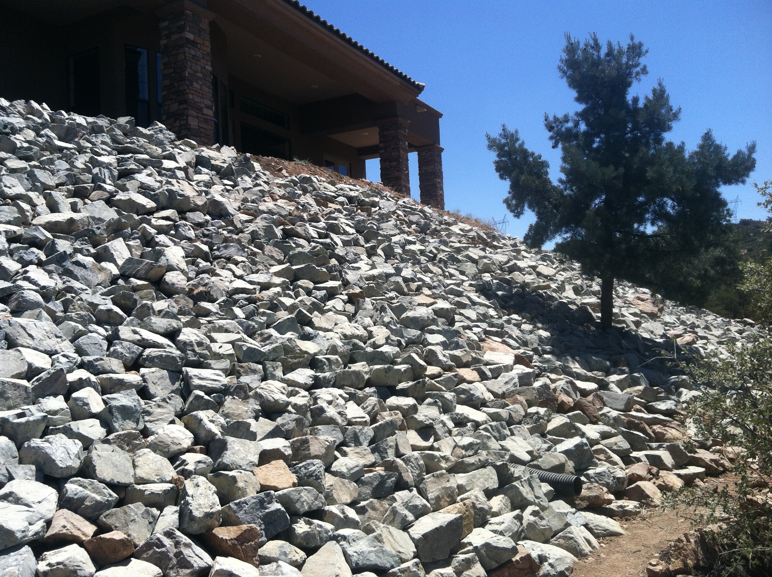 Large rip-rap project.  Looks great and will keep the hillside from eroding away.