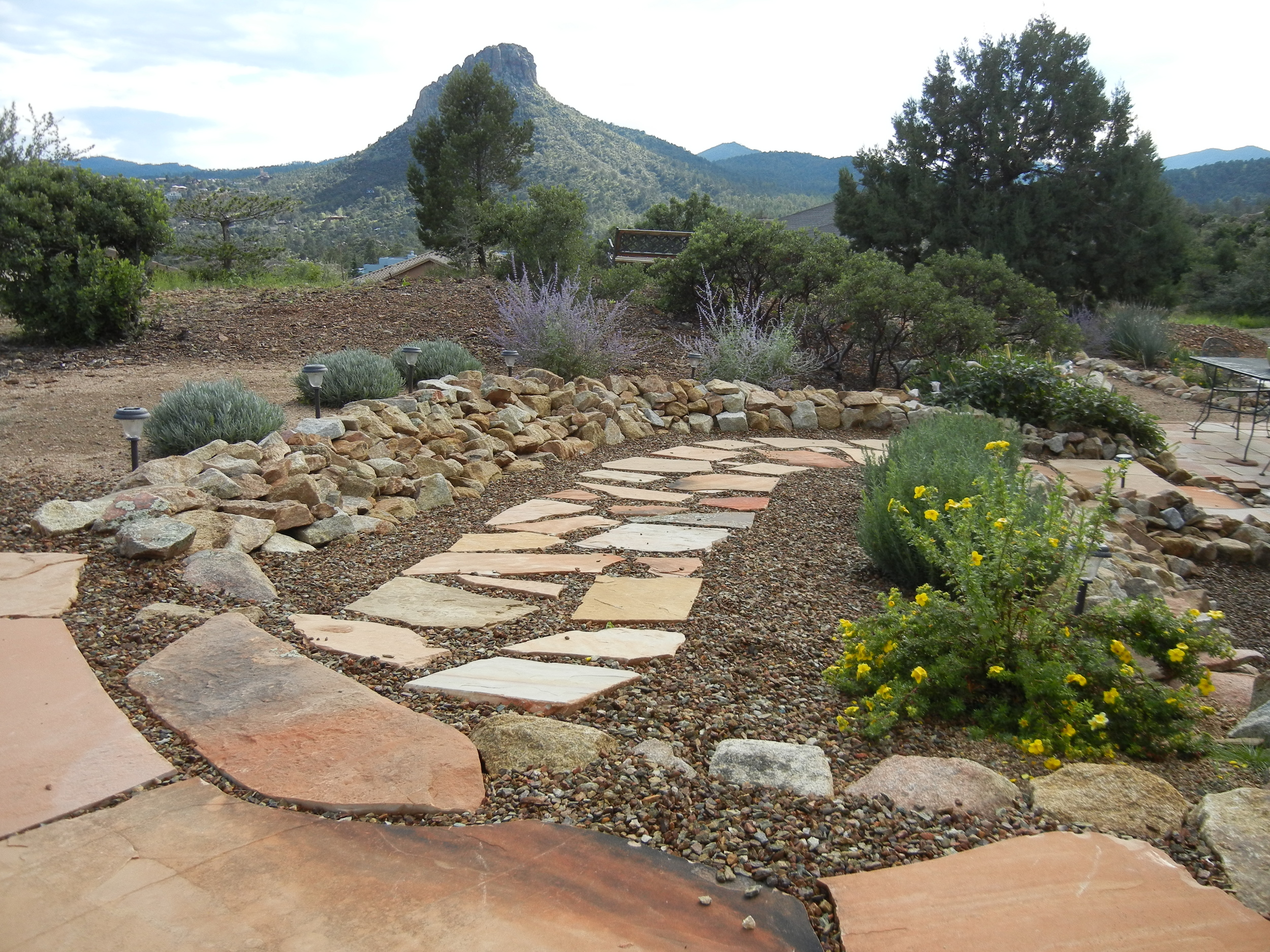Thumb Butte looks over a flagstone walkway