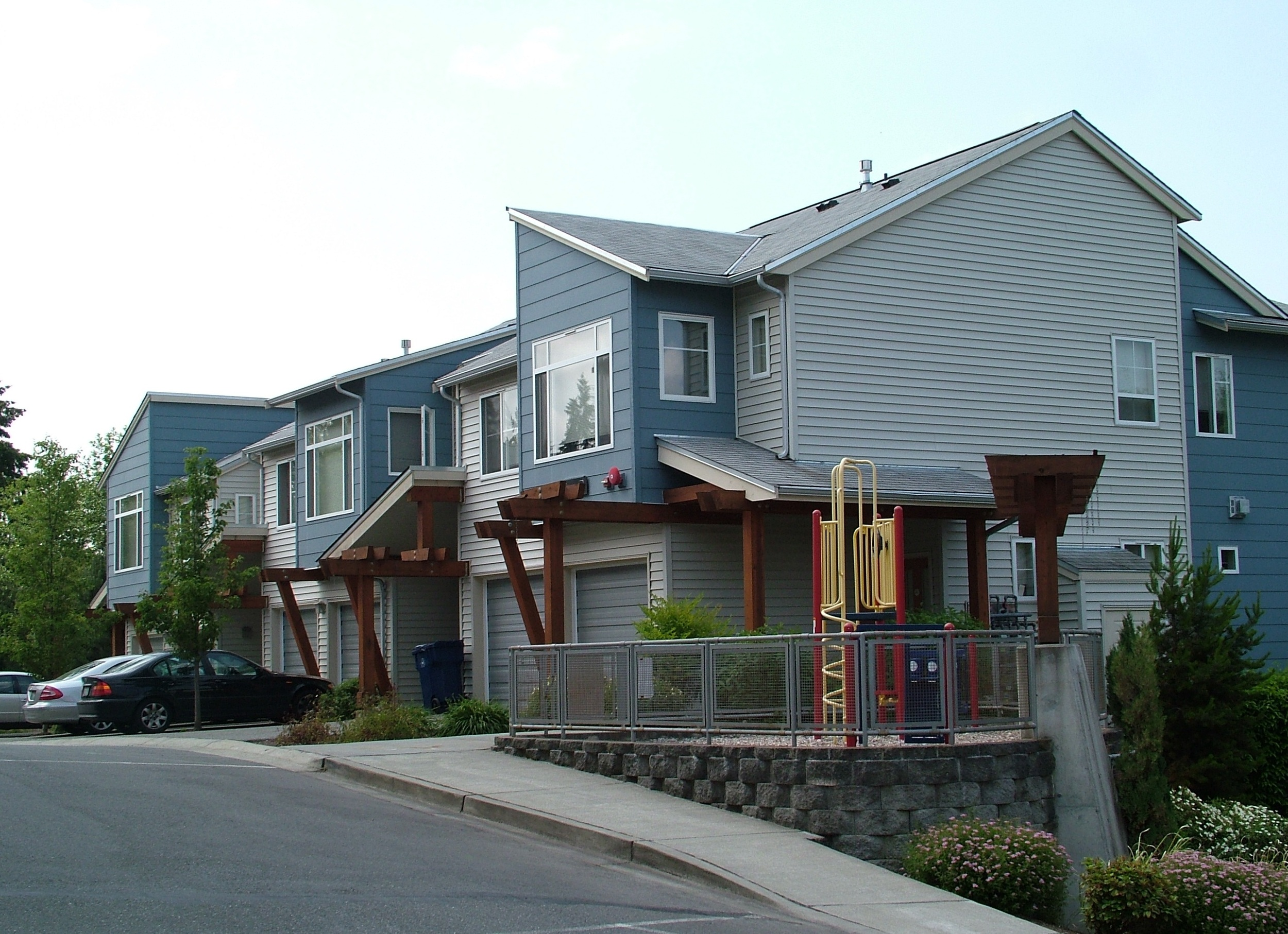 View of play structure and rowhomes