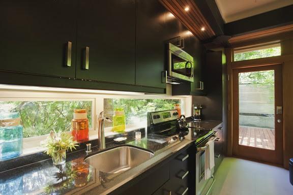 Kitchen with window backsplash.