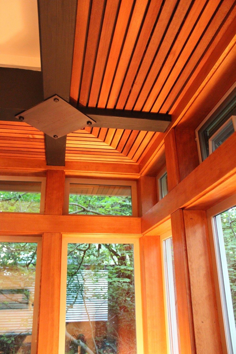 Detail of fir window casework and ceiling soffit.
