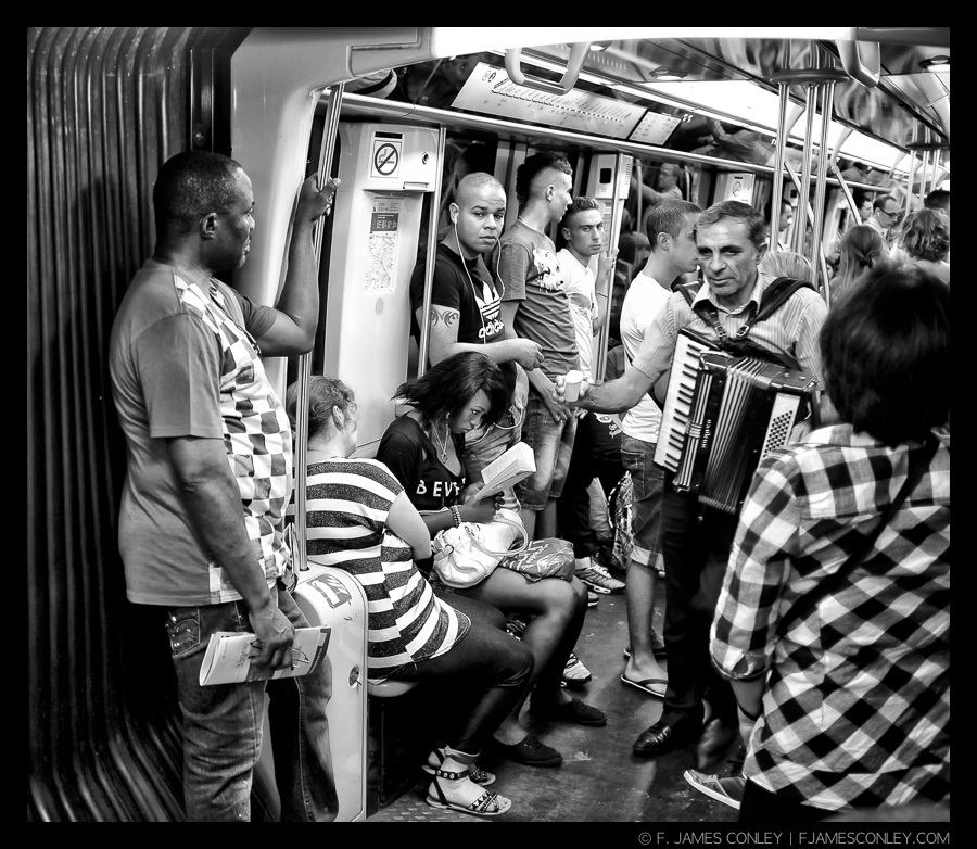 Trying to find a moment to read in the chaos of geometric shapes and the noise of the Paris Metro is a problem of modern life (even if the accordion is kind of quaint).