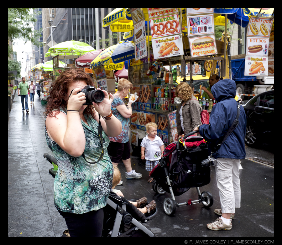 A tourist takes pictures in Manhattan, New York.