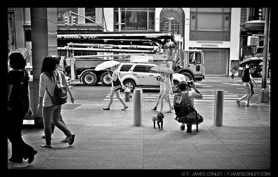 A man takes pictures in Manhattan, New York.