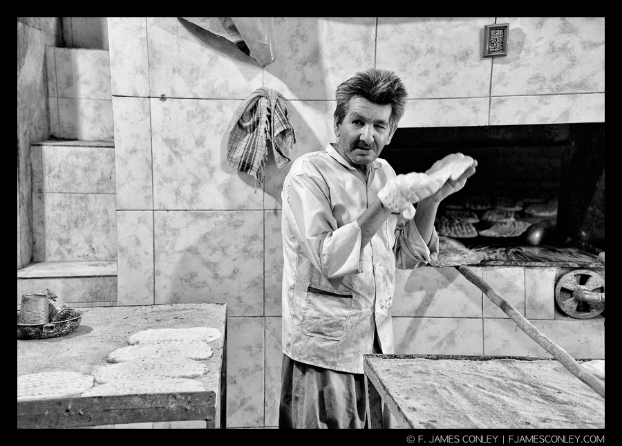 This Iranian baker's environment helps inform the portrait. Cropping it vertically would diminish the information the spectator could use to relate to him.