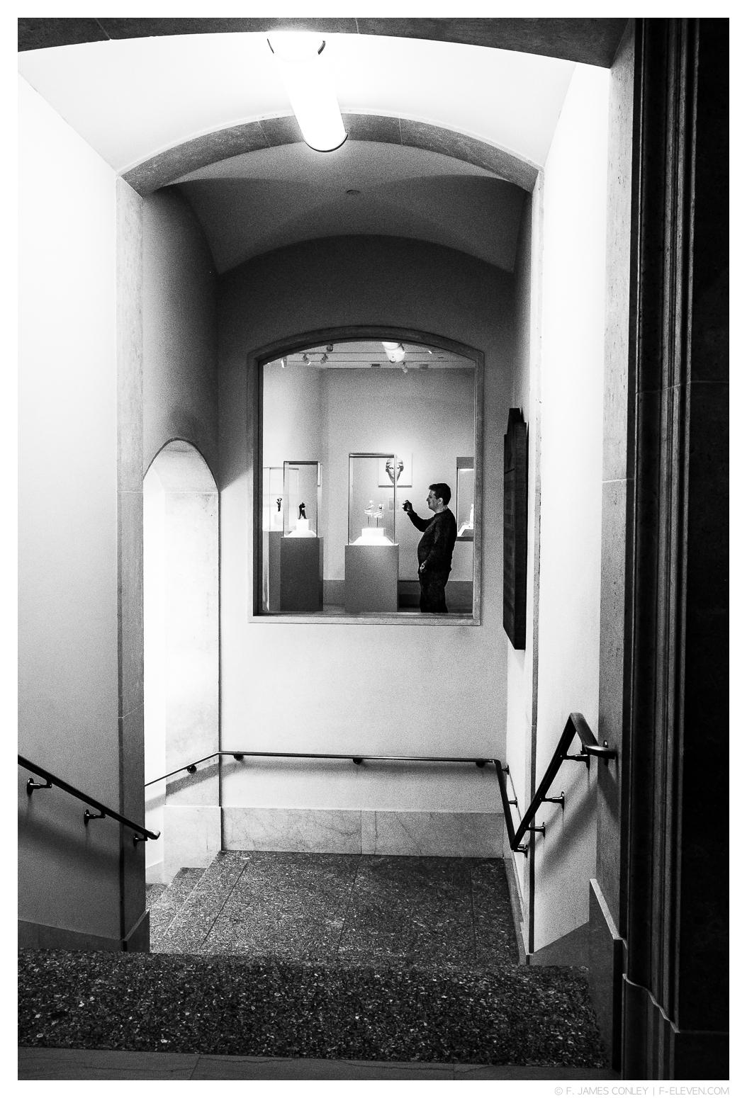 A man photographs art.