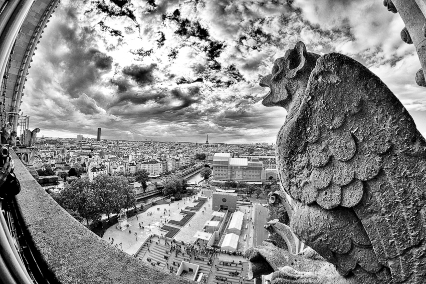 A gargoyle on Notre Dame breathes the clouds into being.