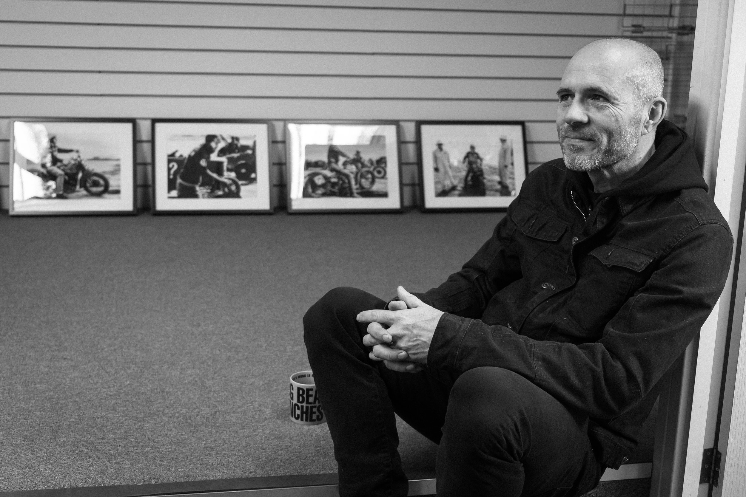 Paul Hayes-Watkins relaxing in his element at Grizzly's, surrounded by prints from TROG.