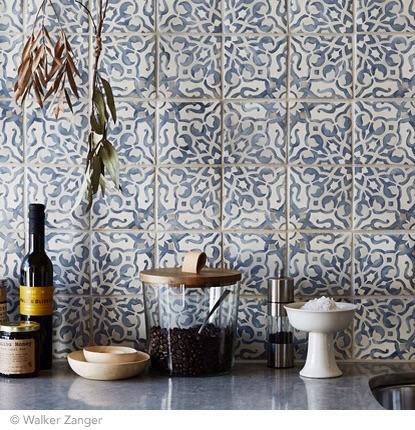 Kitchen backsplash using the Duquesa Fatima in Mezzanotte tile. Image via  Walker Zanger .