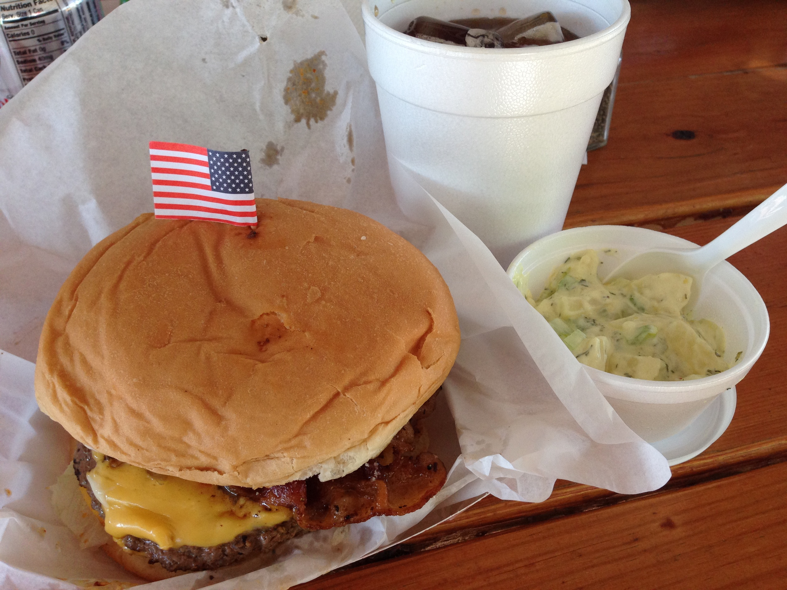The buffalo bacon cheeseburger, with a side of jalapeño potato salad.