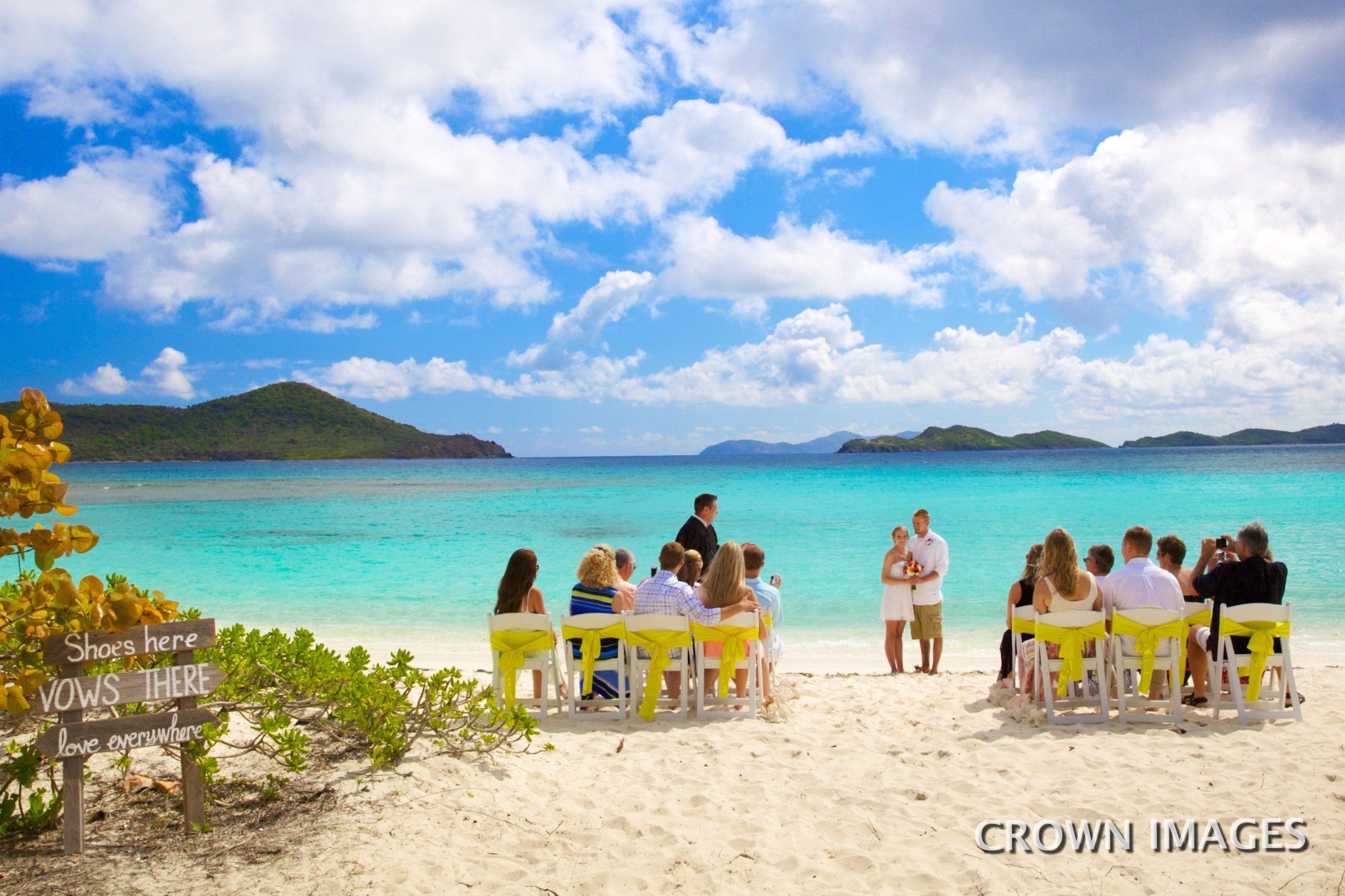 beach wedding ceremony with chairs photo by crown images