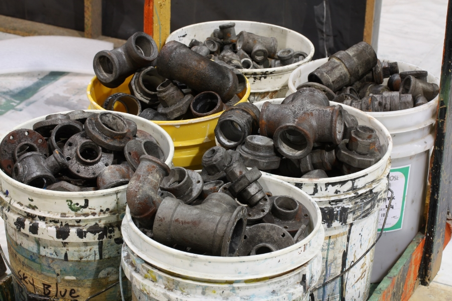 Makin buckets and buckets of hand-made pipe fittings for site-specific installation, Uprising, Suyama Space, Seattle.