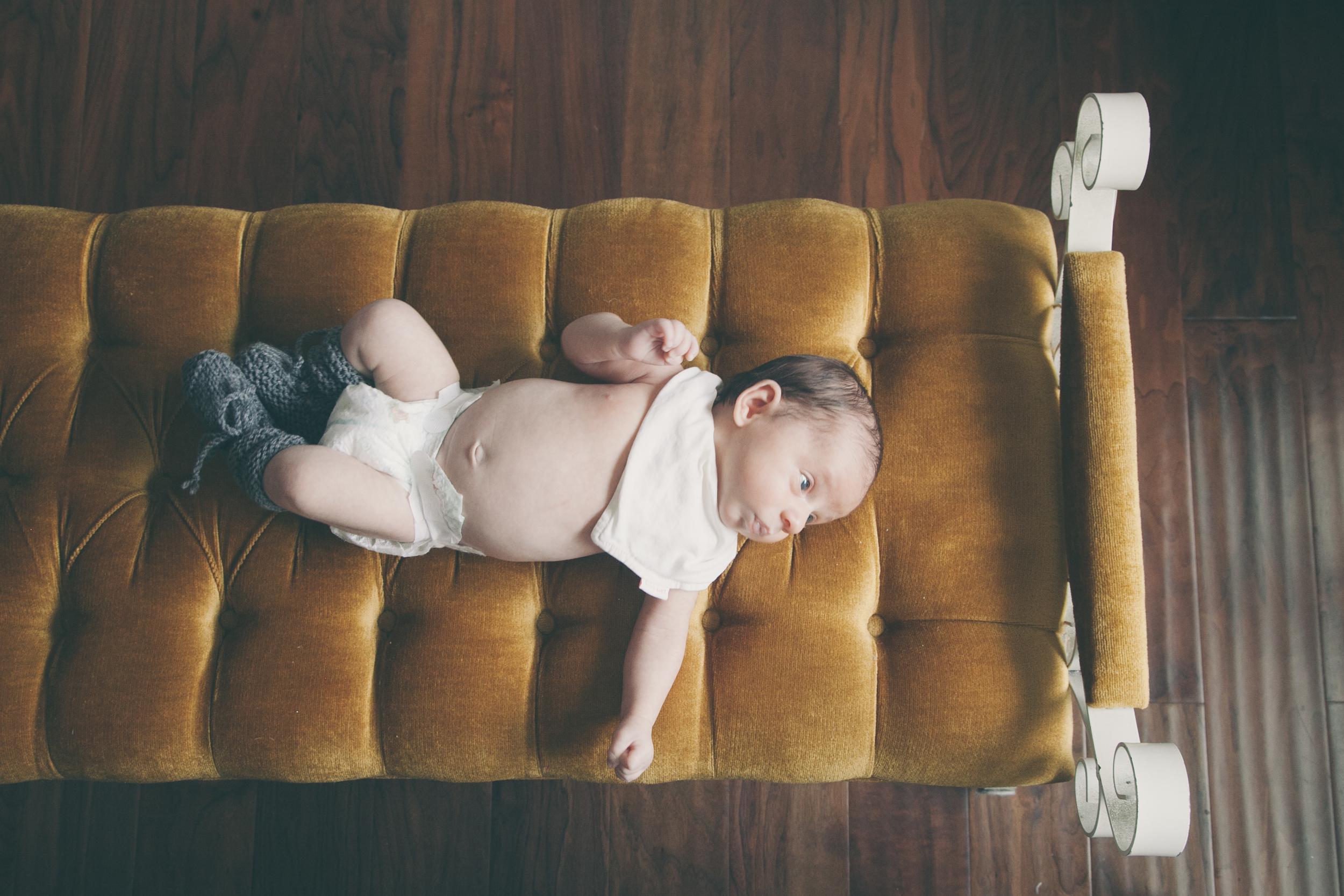 Newborn Baby on Tufted Velvet