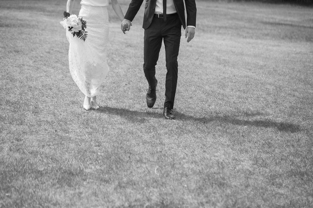 bride and groom walking strathearn
