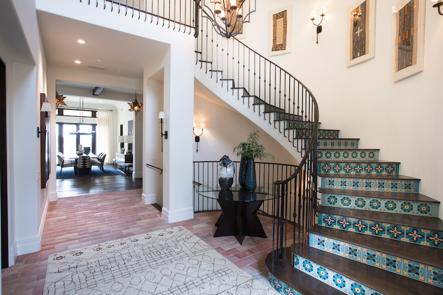 Hilltop Hacienda is an interior design project by Denise Morrison Interiors featuring a grand entry with custom Spanish tiles.