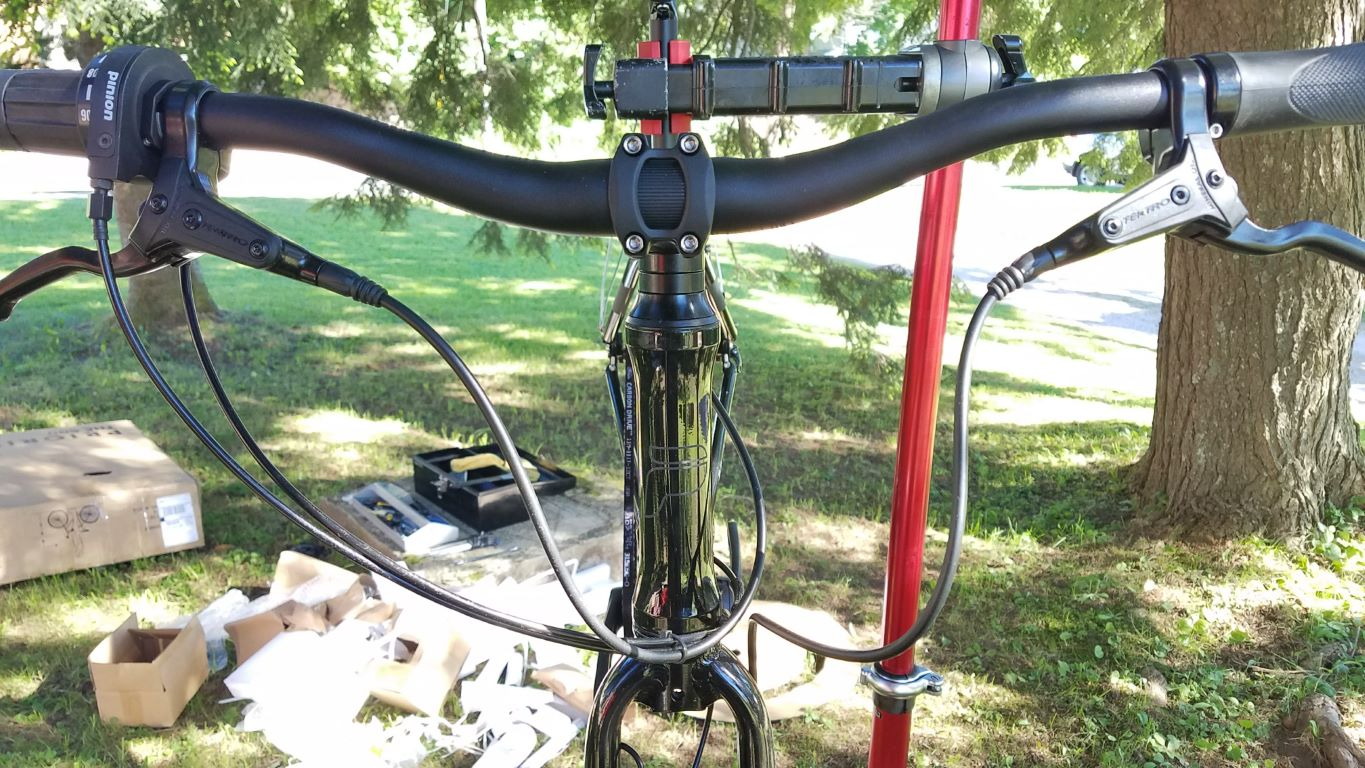 My bike was one of those with the stem pointing backward, so I loosened the two clamping bolts on either side of the stem and spun the stem around to point forward. Then I attached the handlebar assembly.