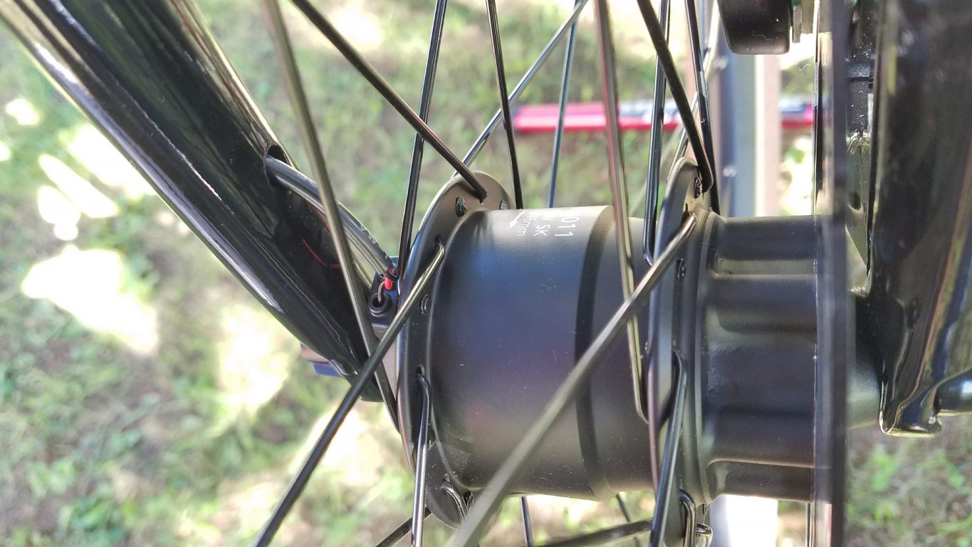 The power connector will rotate until you clamp the quick-release tight, so keep an eye on the connector and hold it where you want it -- behind the fork leg is good! -- until you clamp the wheel into place.