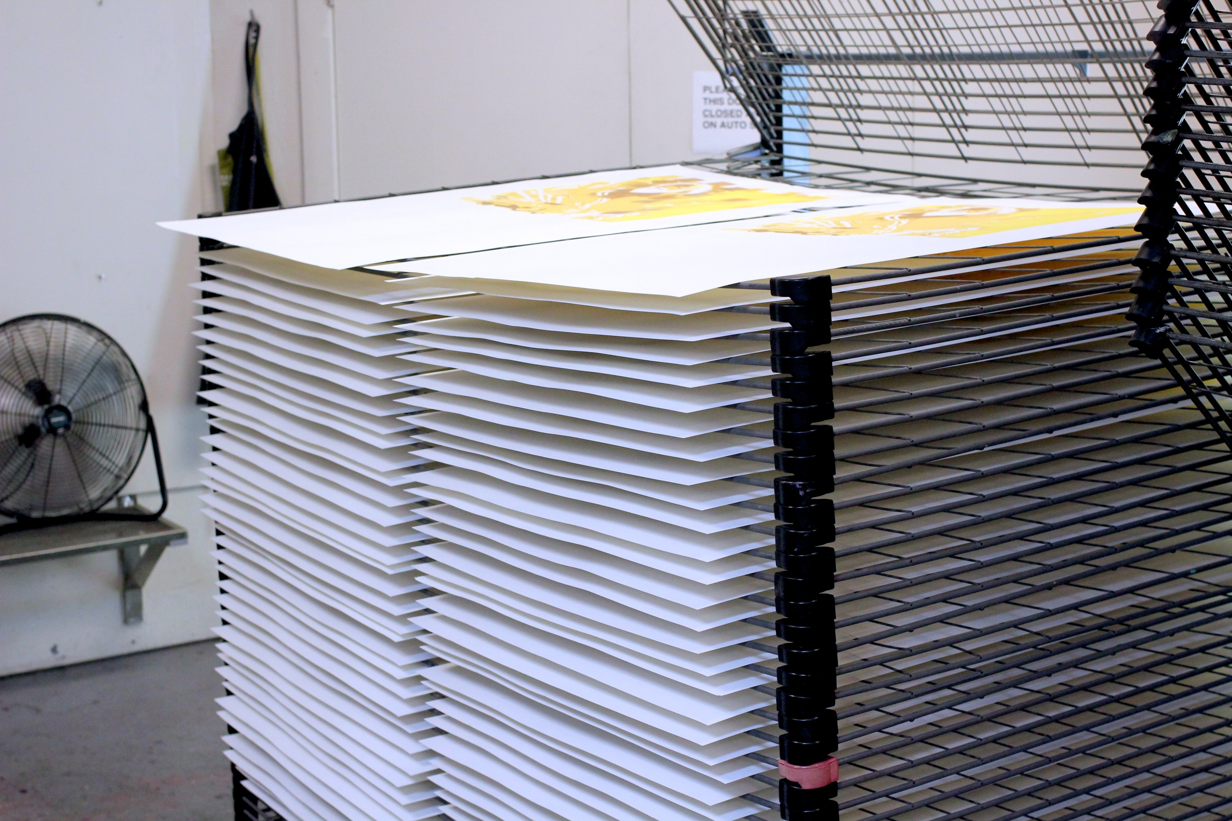 Prints drying in stacks.