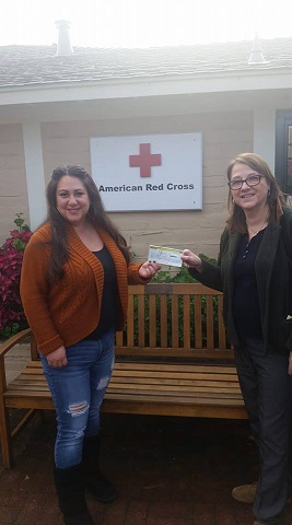 IPMB President Elaine Sorensen presenting donations to the American Red Cross.