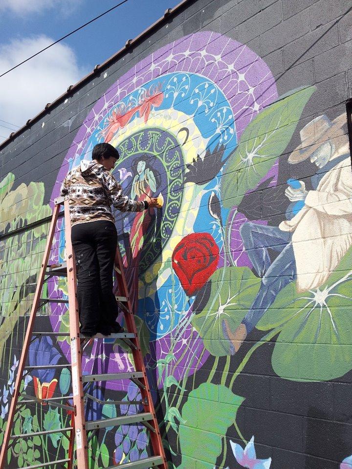 Margaret Morley  working on her beautiful mural