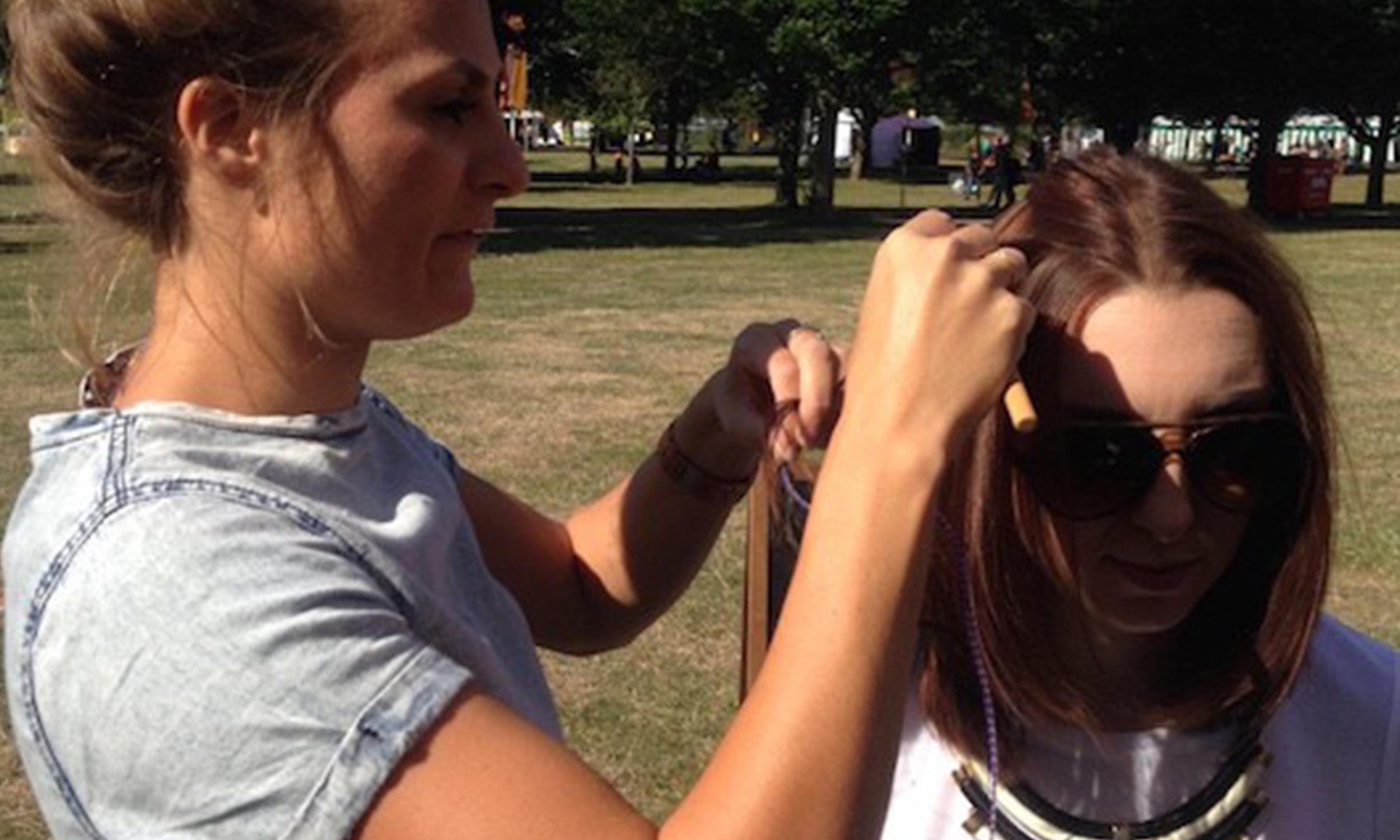 Claudia applying hair feathers