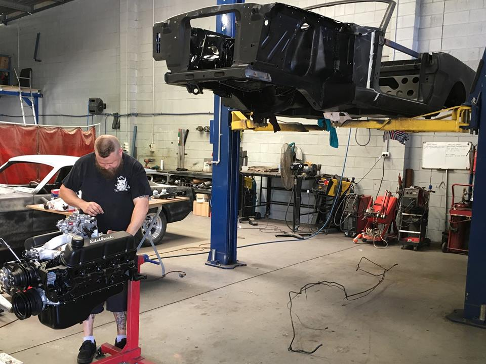 Tim is fitting the engine, trans and the rest of the driveline on the '66 Mustang Convertible ready for body work to commence.