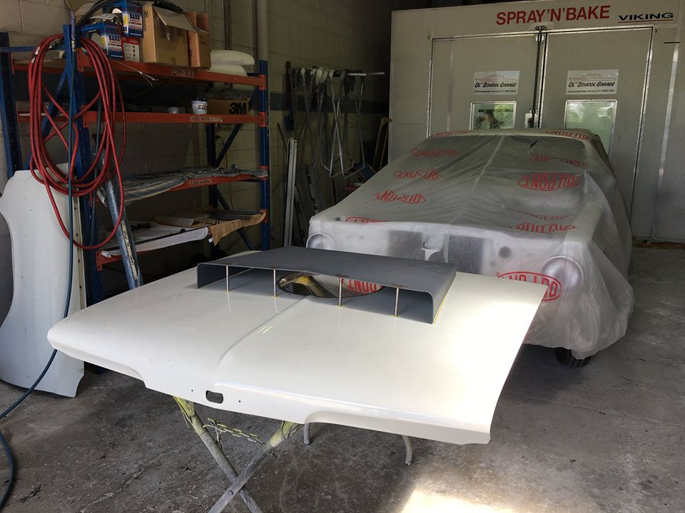 Craig mounted this A-body Hemi bonnet scoop on our customer's Plymouth. It's now in the paint shop to get some matching pearl white paint.