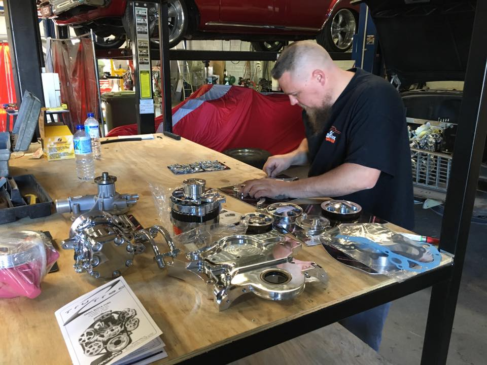 Tim sets out the new serpentine kit so it can be installed on the Fastback.