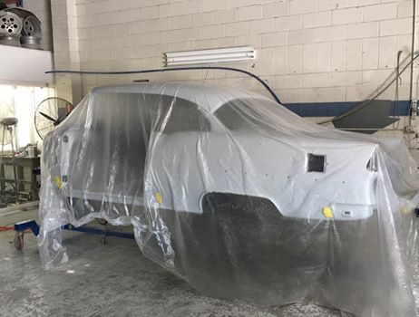 The body sits in epoxy primer waiting for body work to commence on the exterior. But the underside and firewall are almost ready for paint.