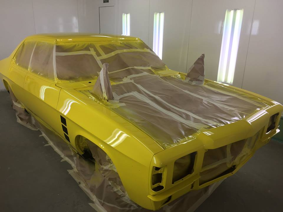 Body work complete, the car is given its new paint livery. The preparation and painting process involves a number of stages and is often the single most labour intensive process in a restoration.