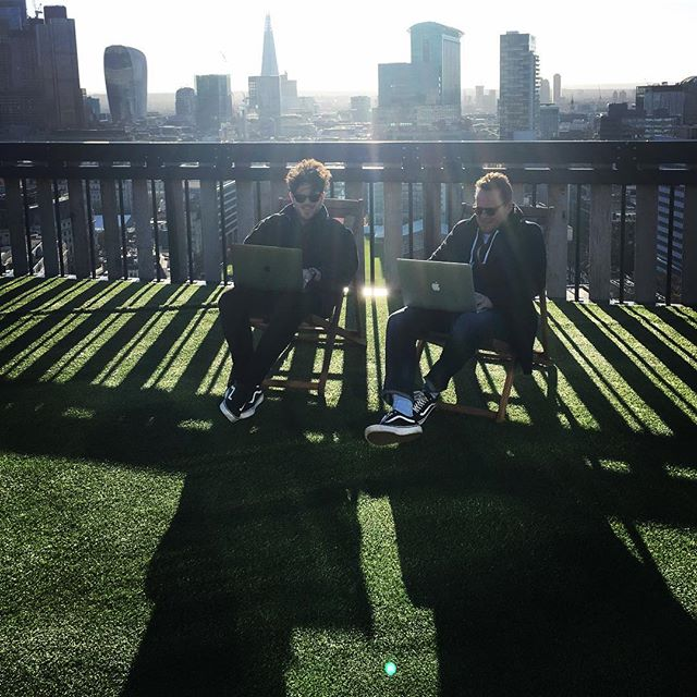 Couple of laid back CEOs getting it done... Photo by @axstrunk  #creativesatwork #rooftoptwats #deckchairlife #definitelynotfreezing #matchingshoes #matchingshades #samerooftopdifferentday